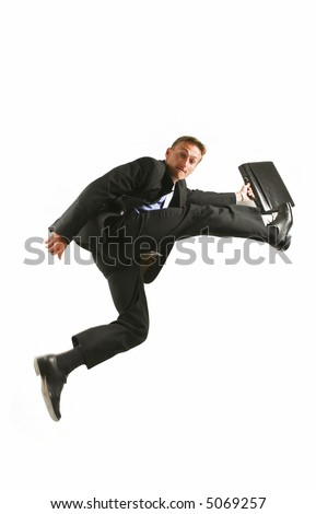 One very happy energetic businessman jumping into the air