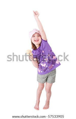 one very happy young girl child celebrating with her arm up and ice cream smiling happily - stock photo