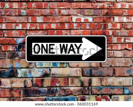 One Way Sign on Brick Wall  - stock photo