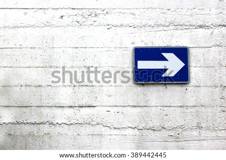 One way sign on white wall