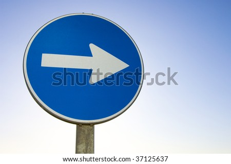 one way signal with blue sky - stock photo