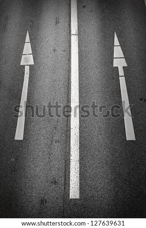 One-way signs on a road/Straight On - stock photo