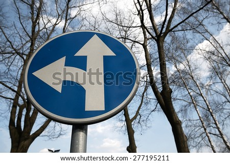 One-way traffic sign standing on the road. - stock photo