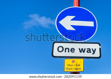 One Way Traffic Signs Against Blue Sky. Space for Copy. - stock photo