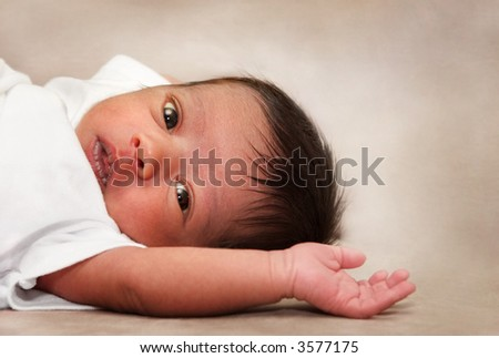 One week old baby - stock photo