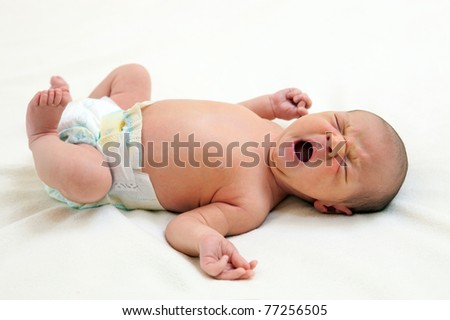 One week old baby boy yawning - stock photo