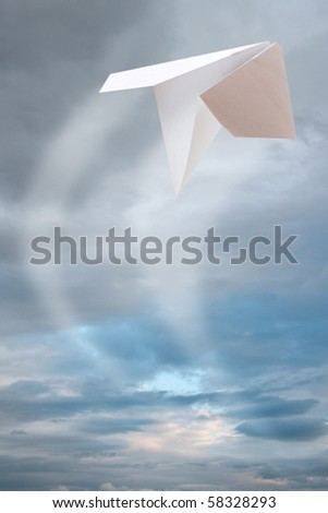 One white paper planes flying - stock photo
