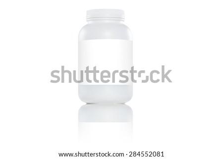 One white plastic bottles with white label on white background - stock photo