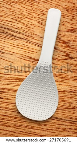One white spatula on the wooden background - stock photo