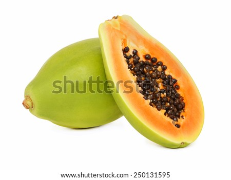 One whole and a half ripe papaya isolated on white background - stock photo