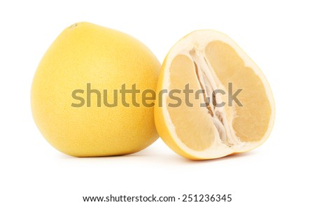 One whole and a half ripe pomelo isolated on white background - stock photo