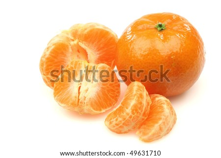 one whole and a peeled tangerine on a white background