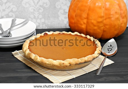 One whole homemade pumpkin pie - stock photo