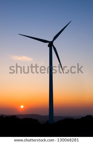 One wind turbine at dusk in vertical composition.