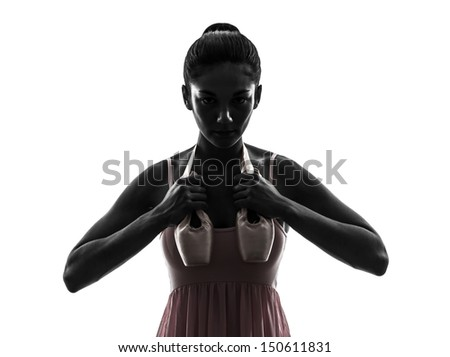 one woman ballerina ballet dancer dancing holding shoes in silhouette on white background