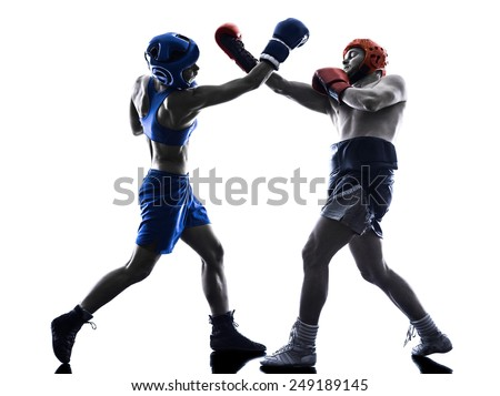 one woman boxer boxing one man  kickboxing in silhouette isolated on white background - stock photo