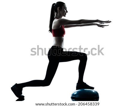one  woman exercising bosu balance ball trainer in silhouette studio isolated isolated on white background - stock photo