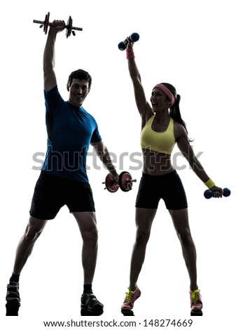 one  woman exercising fitness workout with man coach in silhouette  on white background - stock photo