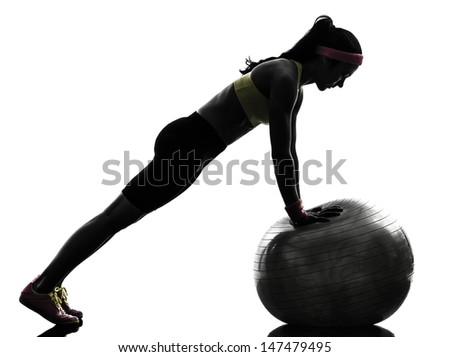 one  woman exercising fitness workout workout push ups  in silhouette  on white background - stock photo