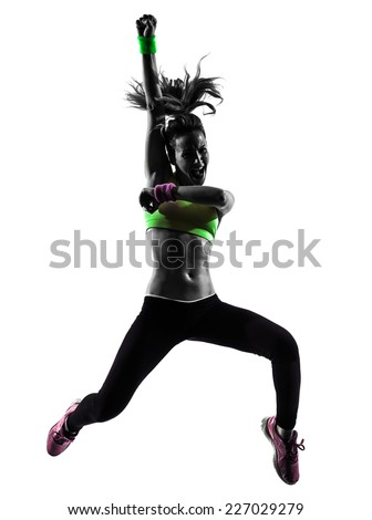 one  woman exercising fitness zumba dancing jumping in silhouette on white background - stock photo