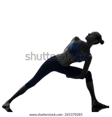 One woman exercising stretching triangle pose yoga in silhouette