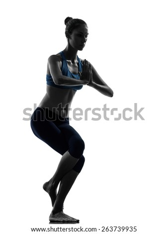 one  woman exercising yoga eagle pose in silhouette studio isolated on white background - stock photo