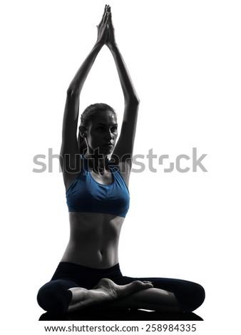 One Woman Exercising Yoga Sukhasana Easy Pose In Silhouette Studio Isolated On White Background - stock photo