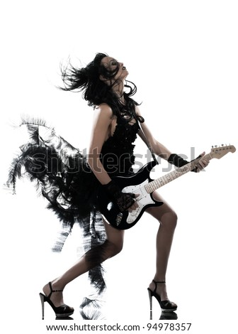 one woman playing electric guitar on studio isolated white background - stock photo