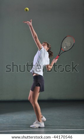one woman playing tennis sport indoor - stock photo
