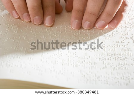One woman reading braille - stock photo