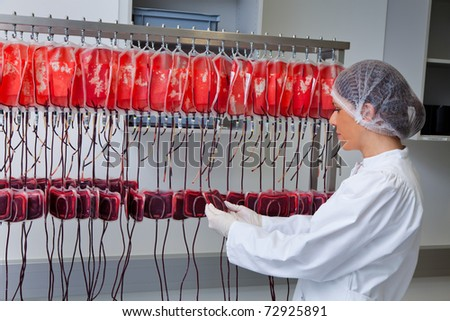 One woman studied in the laboratory, the blood donated blood. Health and Welfare. - stock photo