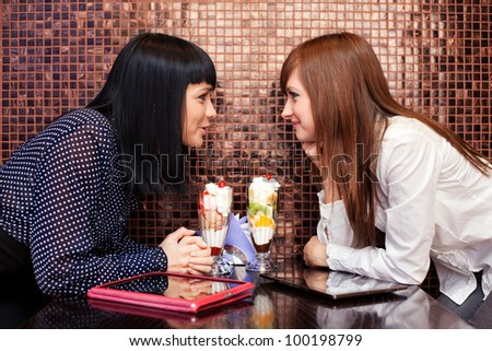 one woman whisper something to friend - stock photo