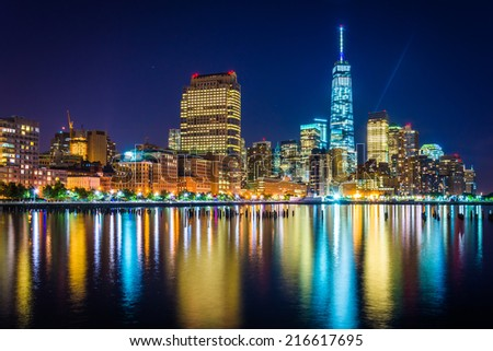 One World Trade Center and Battery Park City at night, seen from Pier 34, Manhattan, New York. - stock photo