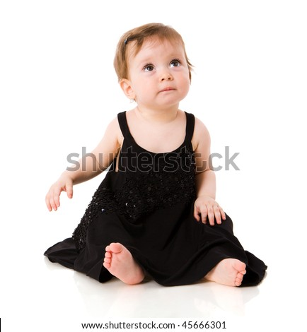 One year baby girl wearing black evening dress isolated on white