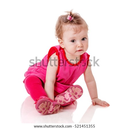 One year baby girl wearing pink dress isolated on white