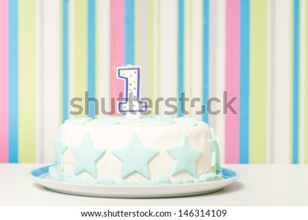 one year birthday cake on the plate - stock photo