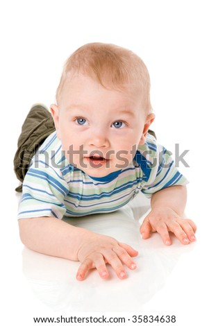 One year boy lying on floor isolated on white - stock photo