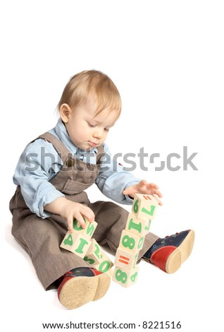 One year boy plays cubes - stock photo
