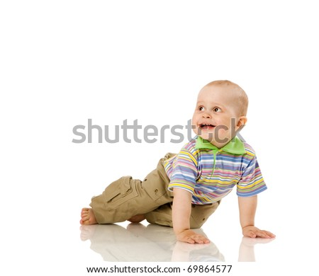 One year boy smiling sitting on floor isolated on white