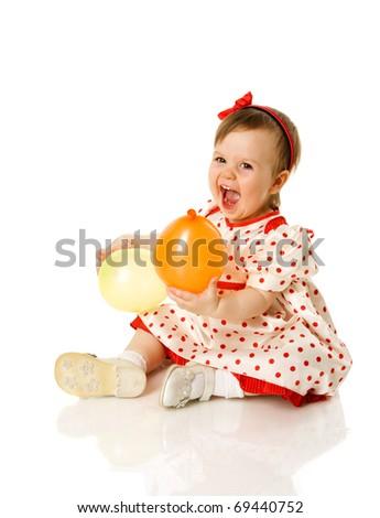 One year girl sitting holding balloons isolated on white - stock photo