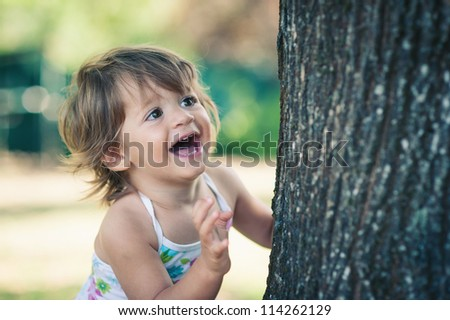 One year little girl playing in the park portrait. - stock photo