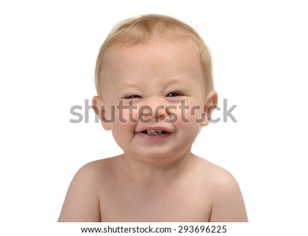 One year old baby boy, Caucasian blond head-shot portrait isolated on white background. making faces.