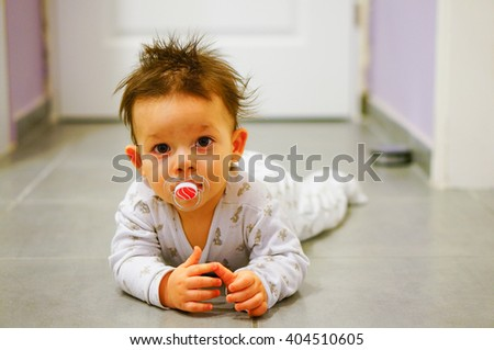 One year old baby boy on the floor - stock photo