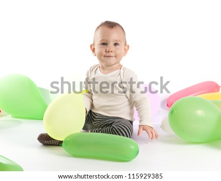 One year old baby boy with balloons - stock photo