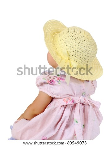 One-year-old baby girl in pink dress and yellow imitation straw hat looking up, isolated on pure white background - stock photo