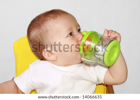 One-year-old baby is drincking water.