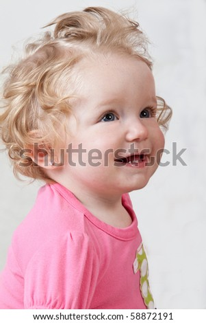 One year old baby wearing pink. - stock photo