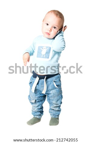 one year old boy playing with the cell phone, isolated on white background - stock photo