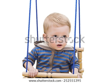one-year-old kid on a rope swing, on the white - stock photo