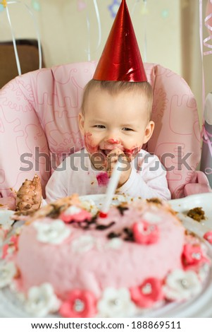 one-year-old little girl solemnize birthday, happy laughter, vertical photo - stock photo